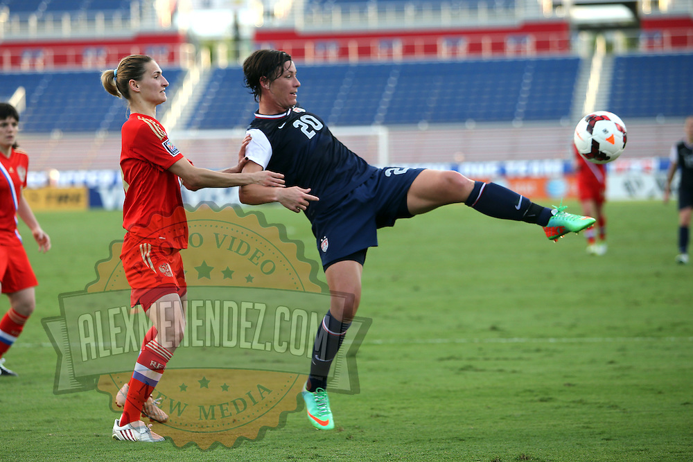 Russia midfielder Alla Sidorovskaya (13) defends against U.S. forward Abby Wambach (20) during an international friendly soccer match between the United States Women's National soccer team and the Russia National soccer team at FAU Stadium on Saturday, February 8, in Boca Raton, Florida. (AP Photo/Alex Menendez)