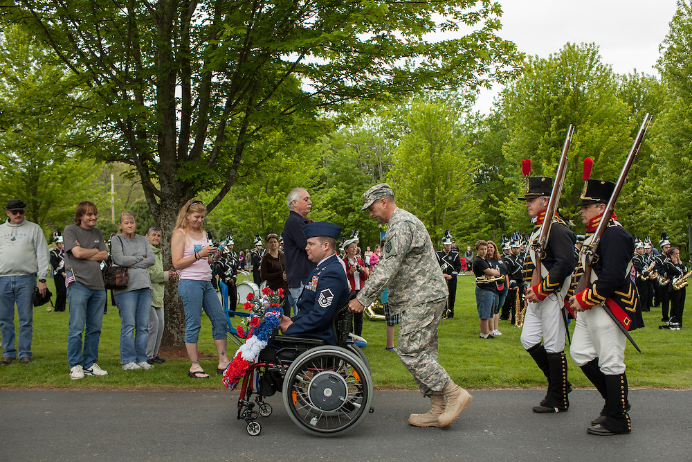 Injured Air Force Master Sgt. Joseph Deslauriers Jr. is wheeled to a war memorial to lay a wreath during Memorial Day ceremonies in his home town of Bellingham, MA on Sunday, May 19, 2013. In 2011, Deslauriers lost both of his legs and part of an arm after stepping on an explosive device while stationed in Afghanistan. He is currently rehabbing at Walter Reed Army Medical Center.  (Matthew Cavanaugh for The Washington Post)