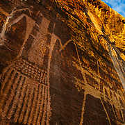 Towering petroglyphs grace the canyon walls of Mckonkie Ranch in Utah.