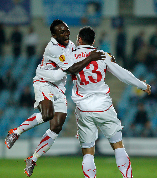 Stuttgart's Timo Gebhart, right, reacts after scoring against Getafe with  Arthur Boka from Ivory Coast, left, during their group H Europa League soccer match at the Coliseum Alfonso Perez stadium in Getafe, near Madrid, Thursday, Nov. 4, 2010.