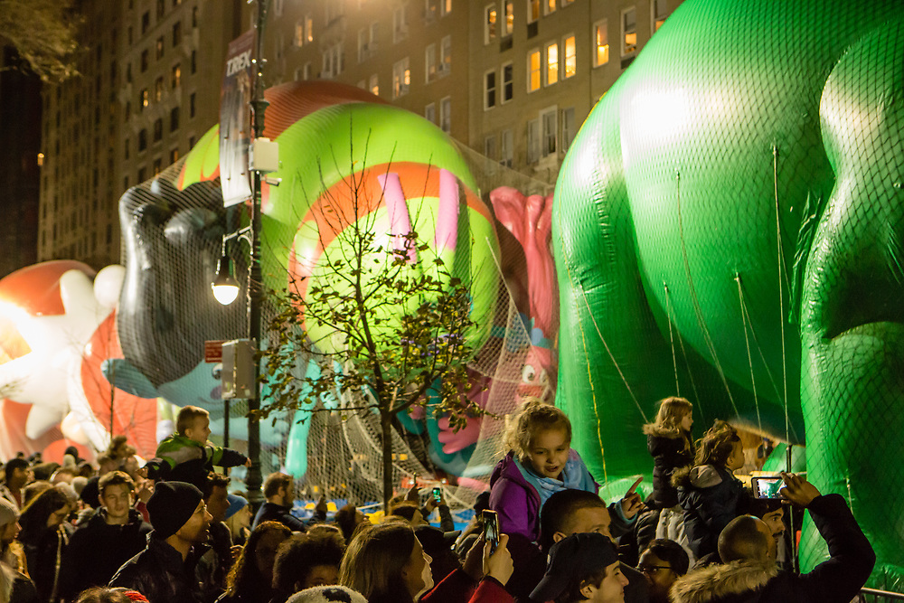 New York, NY – 27 November 2019. Thousands of spectators packed the streets around the American Museum of Natural History to see the inflation area for the balloons for Macy's Thanksgiving Day Parade. Children got a better view from their parents' shoulders.