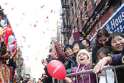 Jan. 31, 2014 - Chinatown, NY. Streamers shot from passing floats rain down on children in the crowd at the Lunar New Year Parade. 01/31/14 Photograph by Natalie Fertig/NYCity Photo Wire