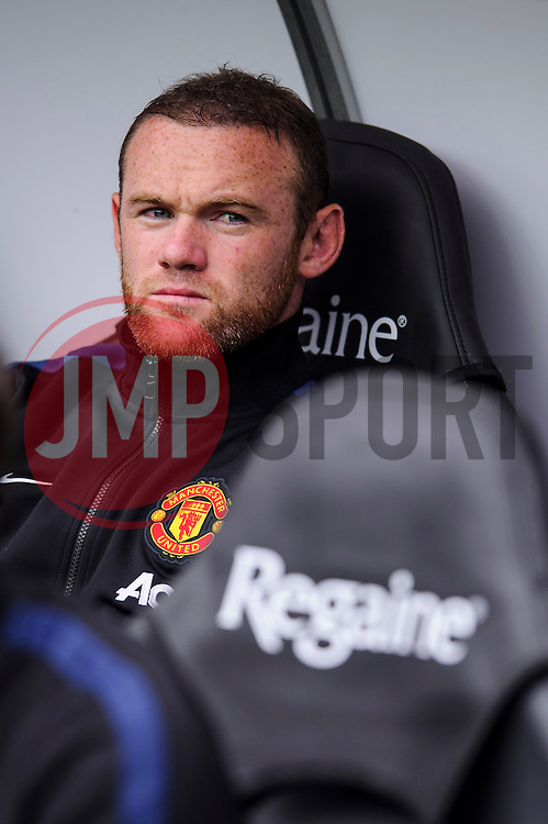 Man Utd Forward Wayne Rooney (ENG) takes his seat on the bench during the first half of the match - Photo mandatory by-line: Rogan Thomson/JMP - Tel: Mobile: 07966 386802 17/08/2013 - SPORT - FOOTBALL - Liberty Stadium, Swansea -  Swansea City V Manchester United - Barclays Premier League - First round of the 2013/14 season and the first league match for new Man Utd manager David Moyes.