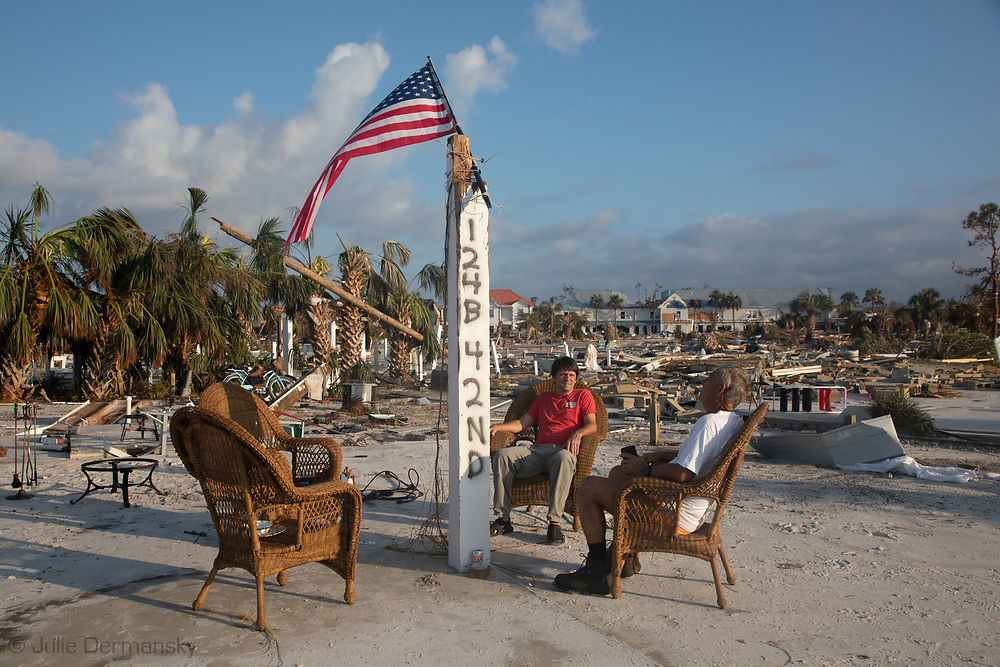 Russell King and his nephew, Dr. Lebron Lackey, in Mexico Beach, Florida, a couple blocks from their home., which was the only beach  house that wasn't badly damaged by Hurricane Michael.