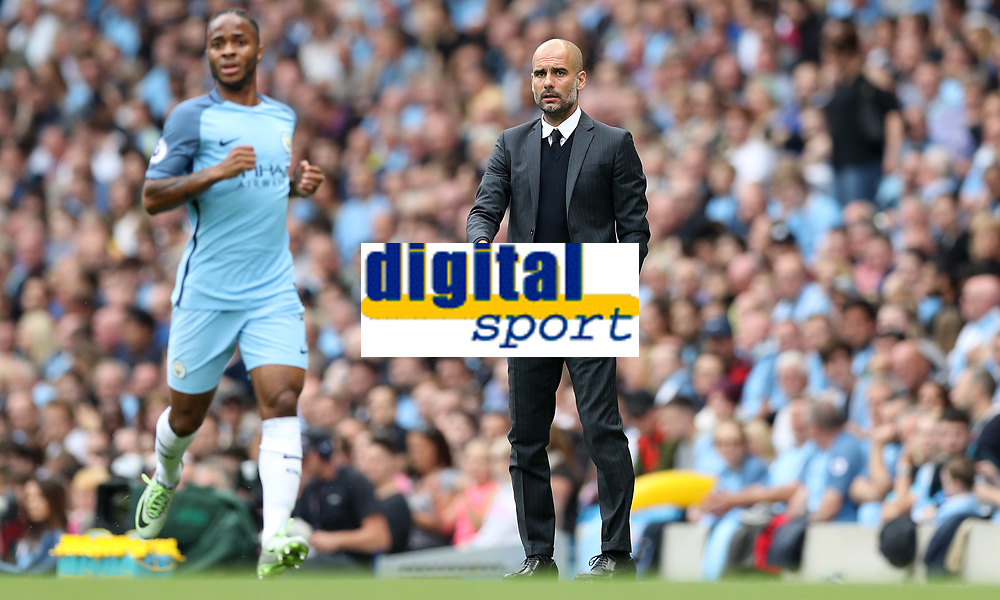 Football - Pep Guardiola and Raheem Sterling of Manchester City during the match at the Etihad Stadium between Manchester City and West Ham United. <br /> <br /> 2016 / 2017 Premier League - Manchester City vs. West Ham United<br /> <br /> -- at The Etihad Stadium.<br /> <br /> COLORSPORT/LYNNE CAMERON