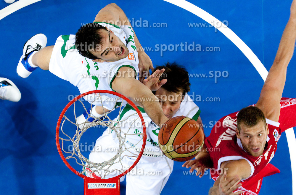 Mirza Begic of Slovenia and Matjaz Smodis of Slovenia vs Sergey Monya of Russia during basketball match between National teams of Slovenia and Slovenia in Group D of Preliminary Round of Eurobasket Lithuania 2011, on September 5, 2011, in Arena Svyturio, Klaipeda, Lithuania.  (Photo by Vid Ponikvar / Sportida)