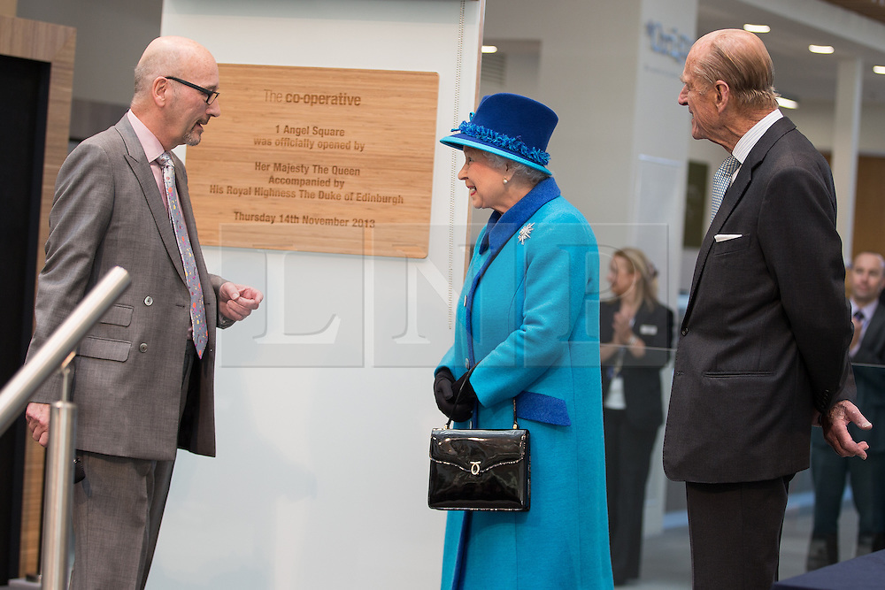 © Licensed to London News Pictures . FILE PICTURE DATED 14/11/2013 . Manchester , UK . LEN WARDLE (left in glasses) with Queen Elizabeth (c) and Prince Philip (r) at the Co-operative's new corporate HQ at 1 Angel Square . The chairman of the Co-operative Group , Len Wardle , has resigned after a sex and drugs scandal involving the group's former banking chairman , Paul Flowers . Queen Elizabeth II and the Duke of Edinburgh visit the Coop building at 1 Angel Square , Manchester , this morning ( 14th November 2013 ) . Photo credit : Joel Goodman/LNP