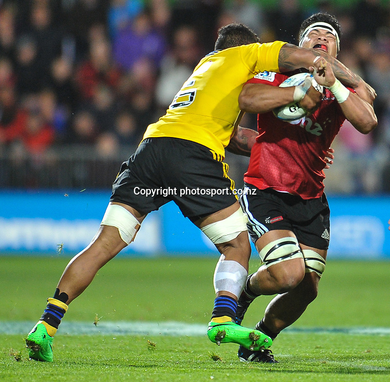 Jordan Taufua of the Crusaders is tackled by Faifili Levave of the Hurricanes in the Super Rugby game, Crusaders v Hurricanes, 28 March 2014. Photo:John Davidson/photosport.co.nz