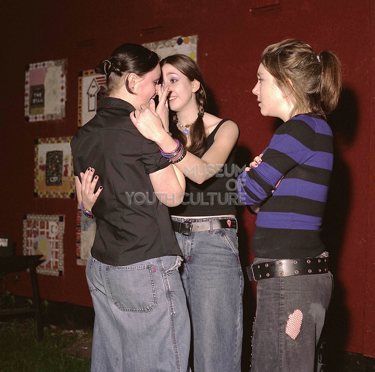 Friends comforting an upset girl, Cardiff 2000's