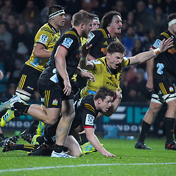 Brad Weber gets to grips with Beauden Barrett during the Super Rugby match between the Chiefs and Hurricanes at FMG Stadium in Hamilton, New Zealand on Friday, 13 July 2018. Photo: Dave Lintott / lintottphoto.co.nz