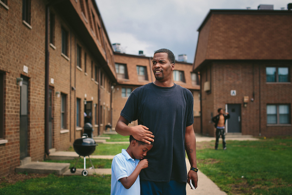 After living in the West Calumet Housing Complex for the first eight years of his life, Lamont Anderson Jr.'s blood tested high for lead. Embraced by his father, he and his siblings still visit his grandmother in the complex, though they moved to neighboring Gary, Indiana, earlier this summer. <br /> <br /> The West Calumet Housing Complex, which is currently home to about 1,200 people, is located on a 79-acre Environmental Protection Agency Superfund site where a USS Lead facility was located in East Chicago, Indiana. Up until 1985, a lead refinery, a copper smelter and a secondary lead smelter were also in the area. The houses were built between the late 1960s and early 1970s.<br /> <br /> <br /> Photo by Alyssa Schukar