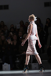 © Licensed to London News Pictures. 14 February 2014, London, England, UK. A model walks the runway at the Bora Aksu catwalk show during London Fashion Week AW14 at Somerset House, London. Photo credit: Bettina Strenske/LNP