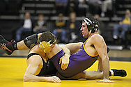 December 8, 2011: Iowa Hawkeyes Derek St. John and Northern Iowa Panthers David Bonin in the 157 pound bout of the NCAA wrestling dual between the Northern Iowa Panthers and the Iowa Hawkeyes at Carver-Hawkeye Arena in Iowa CIty, Iowa on Thursday, December 8, 2011. St. John defeated Bonin 3-1and Iowa defeated Northern Iowa 38-4.