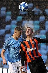 Manchester City U19's Taylor Harwood-Bellis battles for the ball with Shakhtar Donetsk's Kyrylo Romaniuk