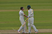 Riki Wessels celebrates his century with Brett Hutton during the Specsavers County Champ Div 1 match between Nottinghamshire County Cricket Club and Durham County Cricket Club at Trent Bridge, West Bridgford, United Kingdom on 29 May 2016. Photo by Simon Trafford.