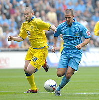 Photo: Ed Godden.<br />Coventry City v Leeds United. Coca Cola Championship. 16/09/2006. Kevin Nicholls (L) chases Coventry's Michael Doyle.