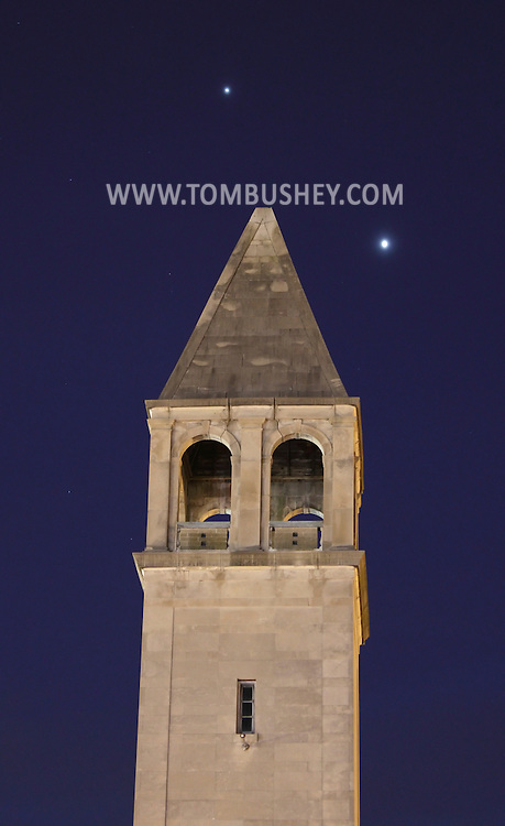 Middletown, New York - The planets Jupiter, top, and Venus, right, shine above the steeple of the former Our Lady of Mount Carmel Church at twilight on March 7, 2012. The building is now the Mulberry House Senior Center