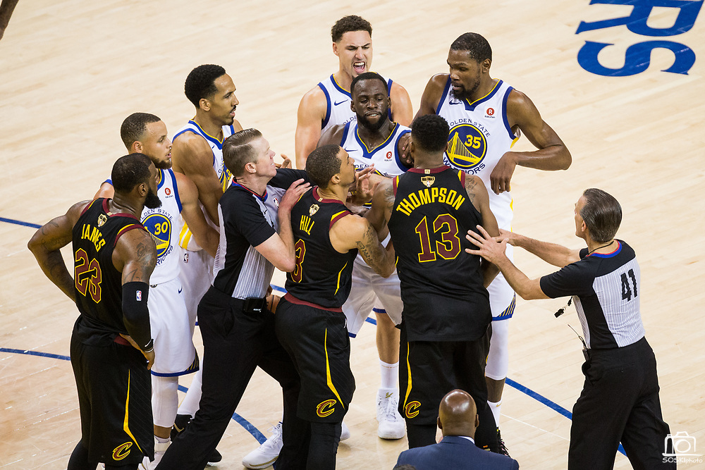 Cleveland Cavaliers center Tristan Thompson (13) hits Golden State Warriors forward Draymond Green (23) in the face with the basketball during a scuffle during Game 1 of the NBA Finals at Oracle Arena in Oakland, Calif., on May 31, 2018. (Stan Olszewski/Special to S.F. Examiner)