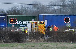 © Licensed to London News Pictures. 2/1/2013. Emergency services  at the scene where a man died when his car is hit by a freight train on a level crossing  on Sandy Lane between Yarnton and Kidlington in Oxfordshire. The man was declared dead at the scene. Photo credit: MarkHemsworth/LNP