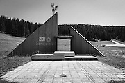 The Haunting Remains of Sarajevo's War-Ravaged Winter Olympics Venue<br /> <br /> From an altitude of 1,600 feet on Mount Trebević, the sight of Sarajevo to the north is truly superb. However, the Bosnian capital is a long way off, and its bustling streets are a far cry from the scenery surrounding this vantage point. Here, decaying slabs of concrete wrestle with vegetation as nature attempts to reclaim a long-empty structure. The colorful designs of local graffiti artists also decorate the man-made construction – as do, upon closer inspection, the traces of war.<br /> <br /> These are the ruins of Sarajevo's 1984 Winter Olympics bobsleigh and luge track, and its bare bones tell a grim tale. The tens of thousands of excited, expectant spectators who turned up to watch a record-breaking number of competing countries are long gone. Today the site is only eerie and silent and acts as a stark reminder of the destruction wrought by conflict.<br /> <br /> In 1978 it was decided that the 14th Winter Olympic Games would be held in Sarajevo, and the choice was a significant one. It was to be the inaugural winter Olympic competition to be staged in a Communist nation and represented a neutral location in a world still in the throes of the Cold War.<br /> To transform the city into an Olympic hub, the hosts spent approximately $150 million – or the equivalent of around $347 million now – developing the necessary sporting structures, lodgings and transportation links.<br /> To transform the city into an Olympic hub, the hosts spent approximately $150 million – or the equivalent of around $347 million now – developing the necessary sporting structures, lodgings and transportation links.<br /> In the city itself, the five rings of the Olympics logo were placed on a central tower, and the Zetra facility was erected for skating events. Indeed, Sarajevans were very proud of their successful Olympic bid.<br /> Forty-nine countries went on to field 998 male and 274 female athletes over the course of 39 events during the games. T
