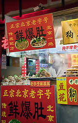 Take-away noodle stand, night market, Beijing, China.