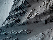 This image covers the northern edge of the largest volcano in the solar system, Olympus Mons on Mars. Mars Reconnaissance Orbiter.