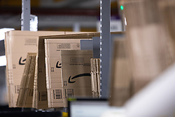"© Licensed to London News Pictures . 04/12/2019. Manchester , UK . Flat Amazon parcel boxes waiting to be filled inside the ""MAN1"" Amazon fulfilment centre warehouse at Manchester Airport in the North West of England . Photo credit : Joel Goodman/LNP"
