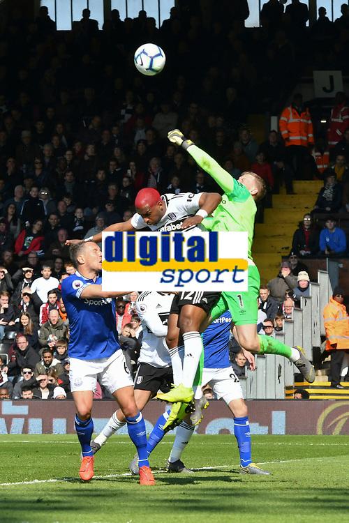 Football - 2018 / 2019 Premier League - Fulham vs. Everton<br /> <br /> Ryan Babel Fulham & Jordan Pickford Everton  leap for the ball , at Craven Cottage.<br /> <br /> COLORSPORT/WINSTON BYNORTH