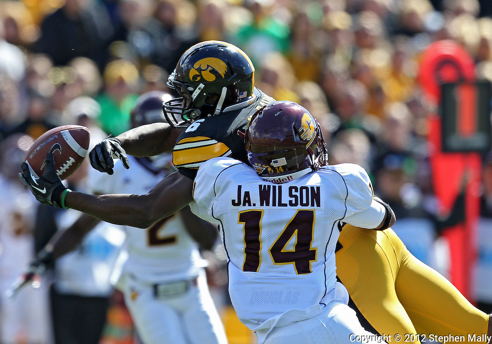 September 22 2012: Iowa Hawkeyes wide receiver Keenan Davis (6) can't pull in a pass as Central Michigan Chippewas defensive back Jason Wilson (14) defends during the first half of the NCAA football game between the Central Michigan Chippewas and the Iowa Hawkeyes at Kinnick Stadium in Iowa City, Iowa on Saturday September 22, 2012. Central Michigan defeated Iowa 32-31.