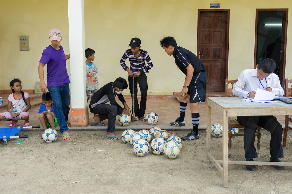 March 05, 2014 - Phnom Penh. Cambodian staff inflates footballs ahead of a Prime Minister's Hun Sen Cup game, Kandal Province. Due to lack of infrastructure many games take place outside of the capital city of Phnom Penh. © Thomas Cristofoletti / Ruom.