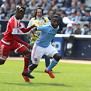 Steven Mendoza, (right), NYCFC, is challenged by London Woodberry, New England Revolution, during the New York City FC Vs New England Revolution, MSL regular season football match at Yankee Stadium, The Bronx, New York,  USA. 26th March 2016. Photo Tim Clayton