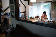 Ralph Paladino eats dinner with his wife Rosemarie at their home in Utica, NY on September 3, 2015, at a table they've owned since they moved into their house in 1979. The Paladinos live primarily on Ralph's police officer's pension and social security, and have home equity loan with an interest rate linked to the prime lending rate. A Fed rate increase would force their already tight budget even further. Photographer: Mike Bradley/Bloomberg