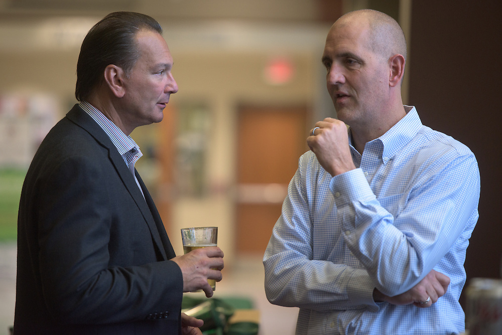 John Koynock, left, and Brad Fischer, right, of Parker Hannifin, talk during the networking hour following the 2016 Schey Sales Symposium held in Baker Center on November 3, 2016.