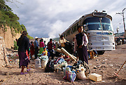 Me'phaa bâ'thââ indigenous families originary from Juanacatlán, Metlatónoc, prepare to board a bus with destination to Michacán to work in the agricultural tomato fields on September 30th, 2009.  (Photo: Prometeo Lucero)