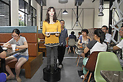 YIWU, CHINA - AUGUST 03: (CHINA OUT) <br /> <br /> delivery robot <br /> <br /> A robot delivers meals at a restaurant on August 3, 2015 in Yiwu, Zhejiang Province of China. Kewang Trade Corporation spent three year to invent delivery robots and security robots. A delivery robot consisted by glass fiber and carbon fiber in the body could carry more than 35-kilogram weight.<br /> ©Exclusivepix Media