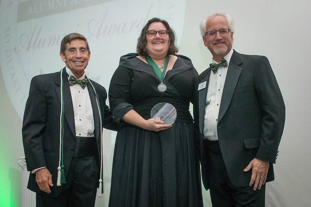 From Left, Larry Starr, Amy Hollis and Ron Teplitzky pose after Hollis was awarded the Distinguished Service Award during the 2016 Alumni Awards Gala at Ohio University's Baker Center Ballroom on Friday, October 07, 2016.