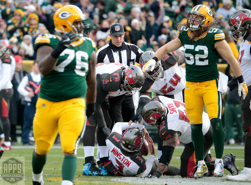 Green Bay Packers defensive end Mike Daniels (76) and Green Bay Packers outside linebacker Clay Matthews (52) celebrate a sack of Tampa Bay Buccaneers quarterback Jameis Winston (3) for a 8-yard loss in the 2nd quarter.<br /> The Green Bay Packers hosted the Tampa Bay Buccaneers at Lambeau Field in Green Bay,  Sunday, Dec. 3, 2017.  STEVE APPS FOR THE STATE JOURNAL.