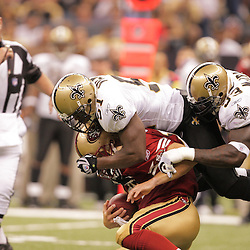 2008 September 28: New Orleans Saints defenders New Orleans Saints linebacker Jonathan Vilma (51) and New Orleans Saints defensive end Bobby McCray (93) combine on a sack of San Francisco 49ers quarterback J.T. O'Sullivan (14) during the NFL week four game between the San Francisco 49ers and the New Orleans Saints at the Louisiana Superdome in New Orleans, LA.