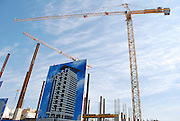 Israel, Tel Aviv, High Rise construction site tower crane lifting iron rods