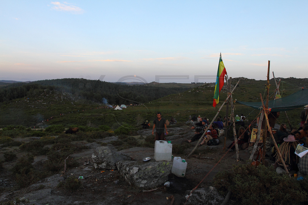 Having a tea while the Full moon is rising. View from the Coffee Mountain in the European Rainbow Gathering of 2011 in Portugal