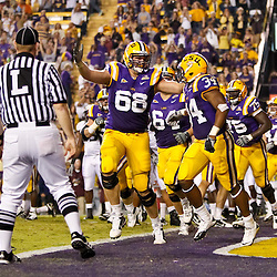 November 13, 2010; Baton Rouge, LA, USA; LSU Tigers running back Stevan Ridley (34) celebrates with teammates following a touchdown during the first half against the Louisiana Monroe Warhawks at Tiger Stadium.  Mandatory Credit: Derick E. Hingle