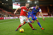 Middlesbrough midfielder Lewis Wing (26) and Ipswich Town defender Myles Kenlock (30) during the EFL Sky Bet Championship match between Middlesbrough and Ipswich Town at the Riverside Stadium, Middlesbrough, England on 29 December 2018.