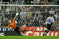Photo. Jed Wee<br /> Newcastle United v Partizan Belgrade, European Champions League Qualifier, St. James' Park, Newcastle. 27/08/2003.<br /> Newcastle's Aaron Hughes (R) misses his penalty to give Partizan the win.