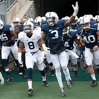 Penn State players run through the tunnel and onto the field before the start of the annual Blue/White game on April 20, 2013 at Beaver Stadium in University Park, PA.