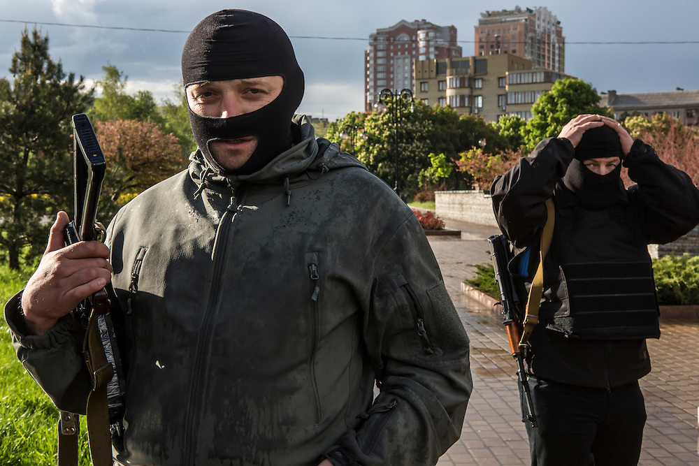 DONETSK, UKRAINE - MAY 8: Pro-Russian activists pose for a picture outside the occupied regional administration building, which serves as their local headquarters, on May 8, 2014 in Donetsk, Ukraine. Tensions in Eastern Ukraine are high after pro-Russian activists seized control of at least ten cities and ahead of the Victory Day holiday and a planned referendum on greater autonomy for the region. (Photo by Brendan Hoffman/Getty Images) *** Local Caption ***