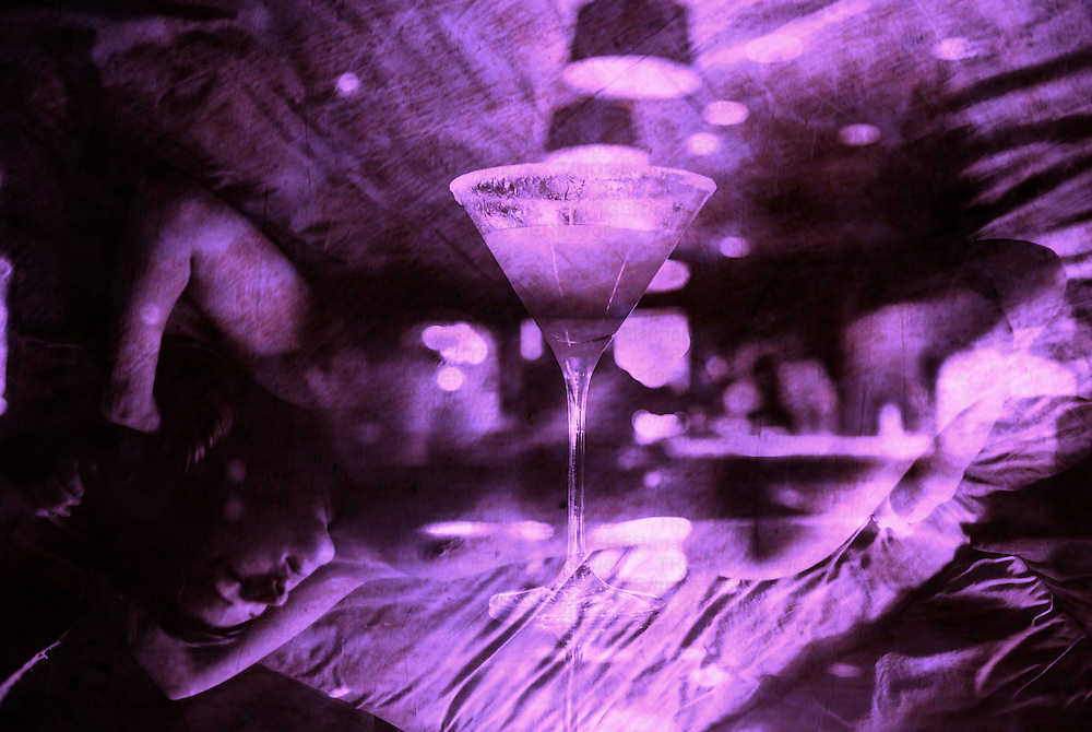Montage of cocktail glass and naked female figure lying on a bed