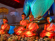 "03 APRIL 2015 - CHIANG MAI, CHIANG MAI, THAILAND: Statues of the Buddha in the ""wiharn"" (prayer hall) at Wat Phakhao, a temple in Chiang Mai, Thailand. The temple was built between 1487 and 1491 and was the home temple for  Thaomekuthisuthiwong, the 15th King of the Mangrai Dynasty, which ruled Chiang Mai before it became a part of Siam (Thailand).      PHOTO BY JACK KURTZ"
