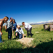 A Teton Science Schools wildlife tour group explores a badger hole near the Shane Cabins Homestead, Wyoming.(Maura Bushior, Katie-Cloe Stock, Tracy Logan, Paul Maddex, Lead Guide Dawson)