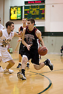 1/6/2006: Freshman guard Trenton Millar (20) of the UAA Seawolves plays tight defense on Johnny Spevak of the Central Washington Wildcats as Anchorage goes on to beat the visiting Central Washington Wildcats, 80-60 at the Wells Fargo Sports Complex on the campus of UAA.<br />