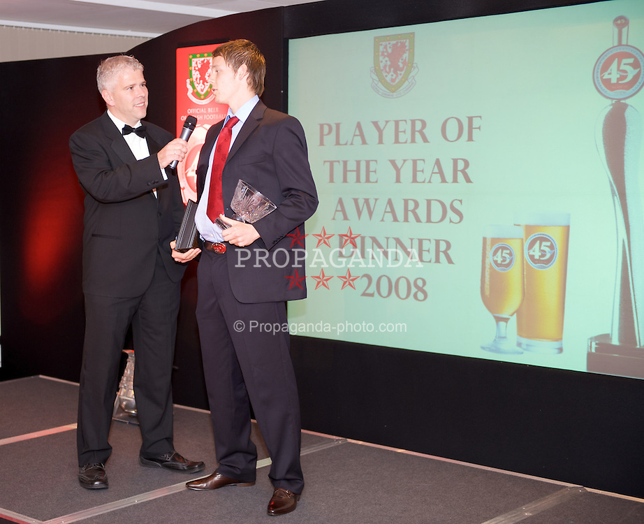 CARDIFF, WALES - Tuesday, October 7, 2008: Wales' Chris Gunter chats to Sky Sports' Bryn Law after winning the Wales Young Player of the Year award at the Brains Beer Wales Football Awards at the Millennium Stadium. (Photo by David Rawcliffe/Propaganda)